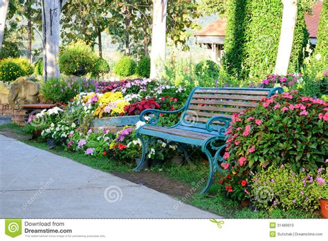 Wooden Outdoor Benches by Flower Garden And Vintage Bench Stock Photos Image 31489913
