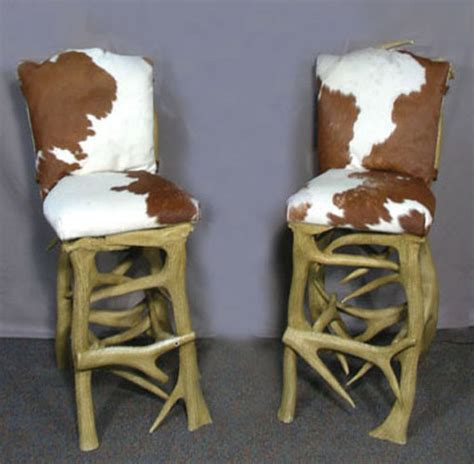 pair heavy composition antler motif bar stools with hide uph