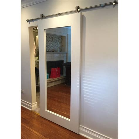 mirror framed sliding barn door by rustic luxe