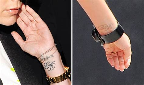 tattoo removal victoria beckham s tribute to david looks faint after she