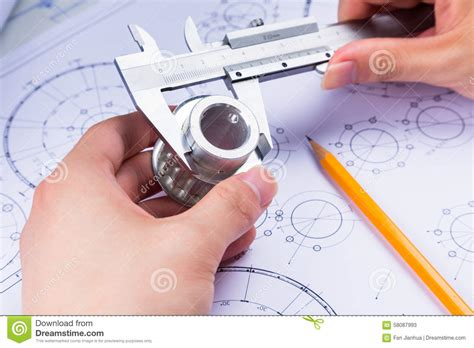 work from home design engineer mechanical design engineer in drawing stock photo image