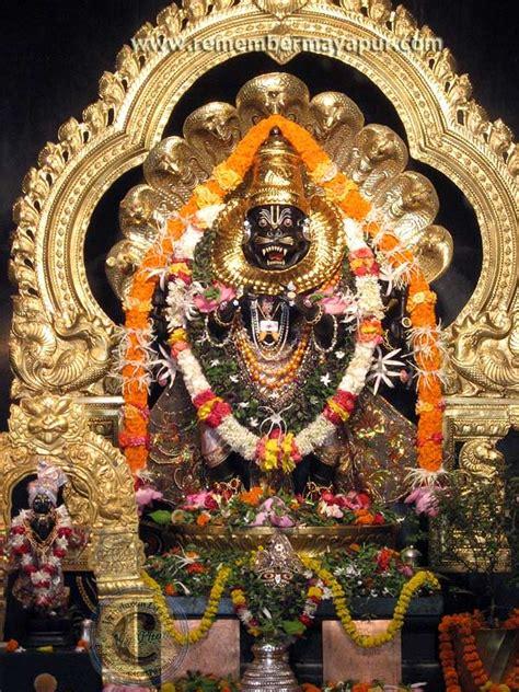 lord narasimha dev hold the lotus feet of the lord nrsimhadev as lord ganesh