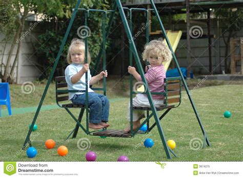 childrens double swing children on swing royalty free stock photo image 3674275