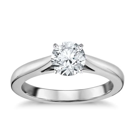 tapered cathedral solitaire engagement ring in 18k white