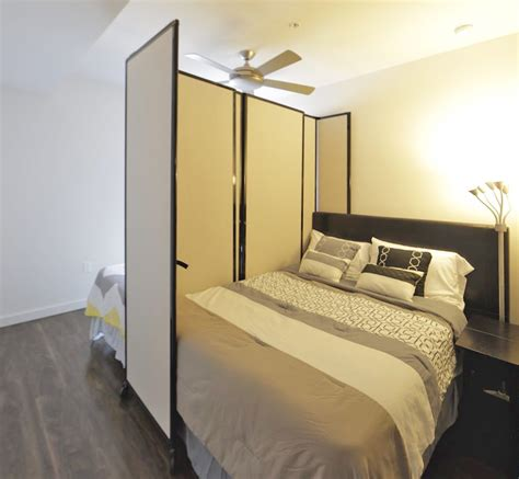partition wall in bedroom versare teams with thehomeshare to divide shared living