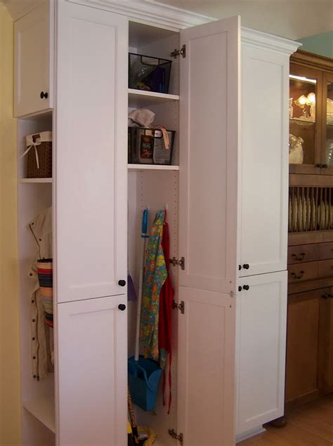 storage cabinets for mops and brooms broom and mop storage cabinet home design ideas