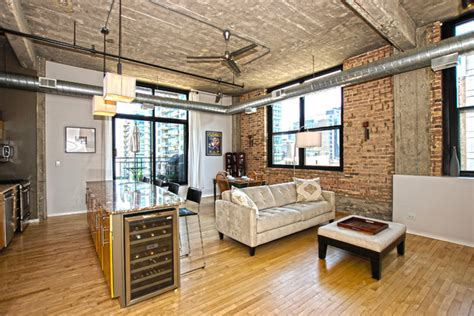 house tour 100 000 industrial chic look in this four sle of best work industrial living room chicago