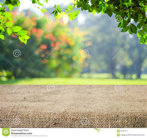 Covered Outdoor Kitchen Plans empty table covered with sackcloth over blurred trees with