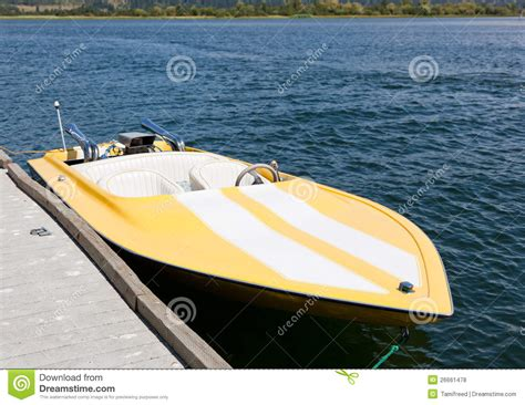 fast yellow boat yellow speed boat stock photo image of motor dock