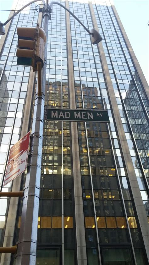 mad from times mad statue unveiled for season jon hamm poses on bench featuring don