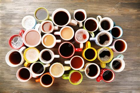 Many cups of coffee on wooden table, top view ? Stock