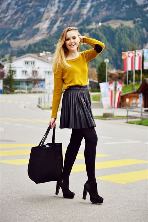 short pleated skirt  tights camel colored sweater