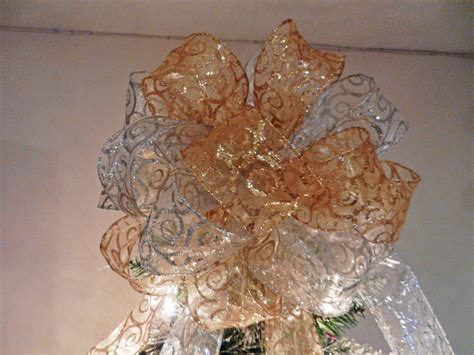 large christmas tree topper bow made with a sheer gold ribbon