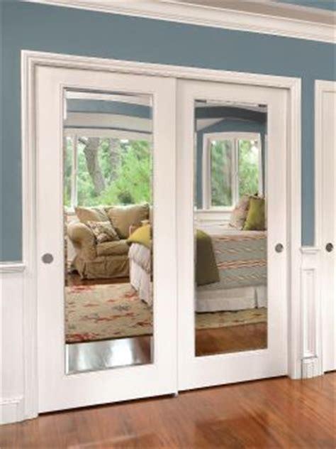 Wood Framed Mirrored Bifold Closet Doors by Wood Mirror Closet Doors Reversadermcream