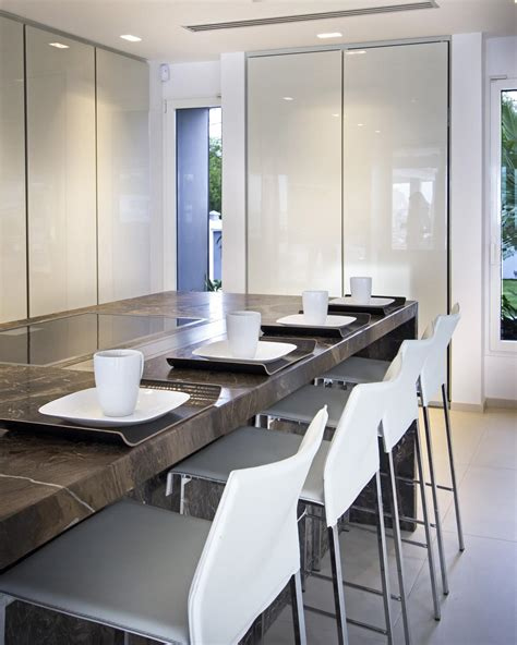 minimalist kitchen and bar counter bar chair photos hgtv eat in kitchen bar with brown marble