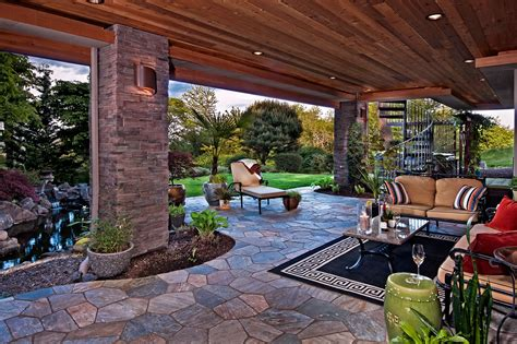 Outdoor living spaces with water feature and greens traba homes