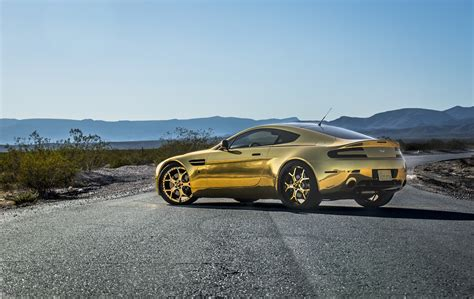 rose gold aston martin gold aston martin on gold forgiato wheels autoevolution