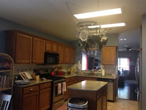 update kitchen lighting how to update hideous fluorescent lighting in kitchen