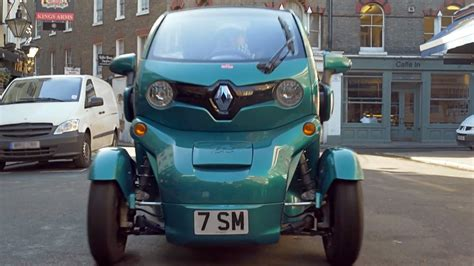 renault twizy blue sir stirling moss drives a turquoise renault twizy in
