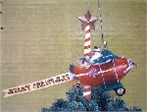 santa and airplane floating tree top