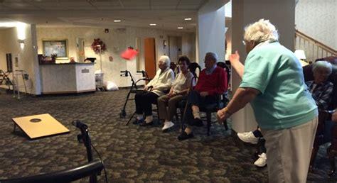 elderly in nursing home tosses bean bags