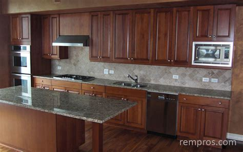 Kitchen with maple cabinets, granite countertop, stainless