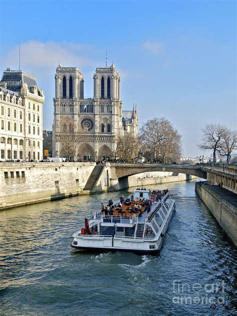 la seine boat trip paris france cathedral notre dame de paris and pleasure boat on the