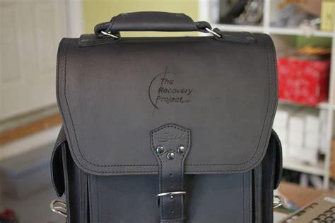engraved on logo engraved on saddleback leather bag in a flash laser