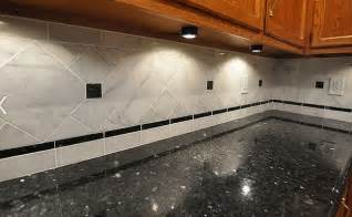 black countertop white marble backsplash backsplash