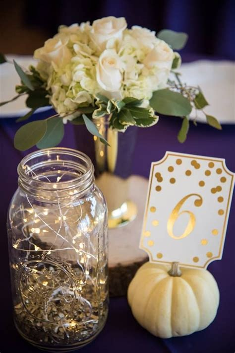 Twinkle lights in mason jars!   Wedding centrepieces