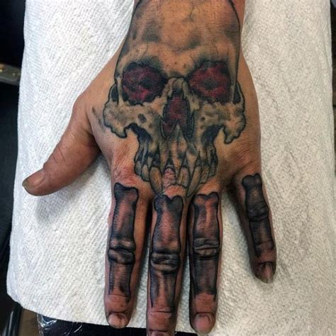 cartoon tattoo on hand cartoon style colored funny vire skull with bones