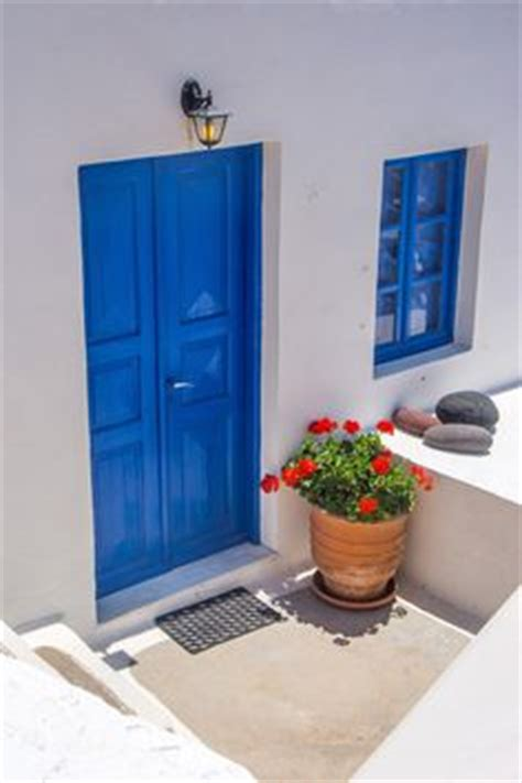 i ll paint our front door and window shutters in santorini blue it will look beautiful against