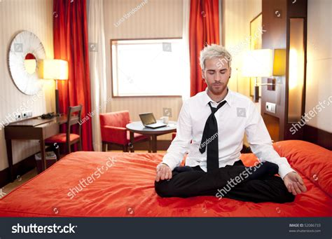 lotus position in bed caucasian businessman meditating in bed in lotus position
