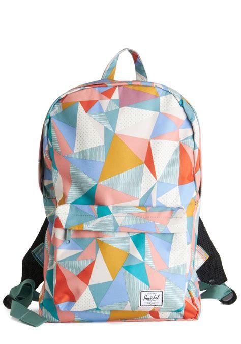 colorful backpacks midday magic earrings geometric colorful