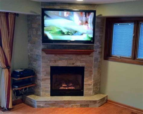 Corner Fireplace With Tv Above by Decorations Corner Fireplace Designs For Modern Decorated Interior Corner Fireplace Designs