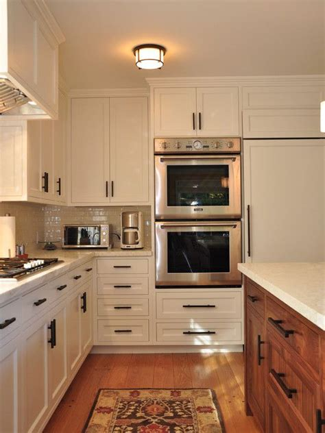 white cabinet bronze hardware white cabinets with a wood island dark bronze pulls to