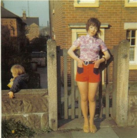 1970s feather cut lilac lacey top red and navy hotpants and feather cut