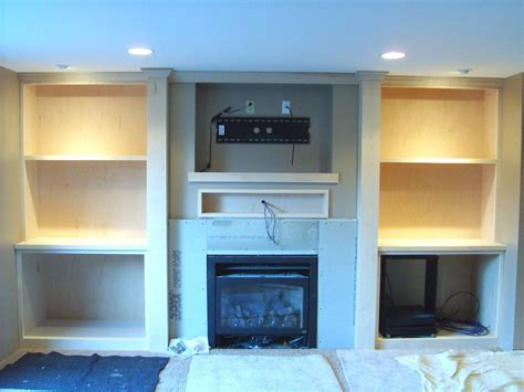 fireplace mantel with flatscreen tv finish carpentry