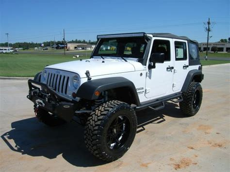 jeep lifted white 2012 jeep wrangler unlimited sport with a 4 quot rancho lift