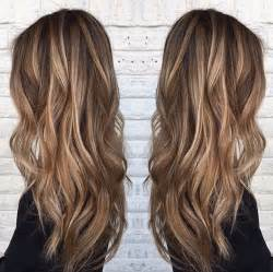 medium brown hair with platinum highlights balayage underneath