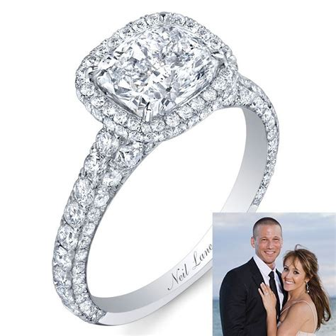 neil platinum engagement ring with a cushion cut