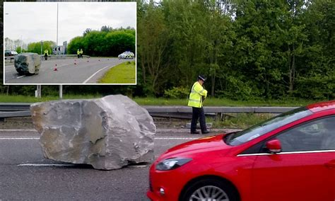 Wedding Falling Back Of Car by A Real Rocky Road Boulder Causes Hold Up On Dual