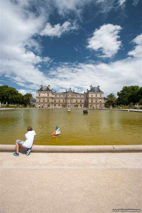 sailboats at luxembourg gardens park play before after a boy plays with a sailboat at