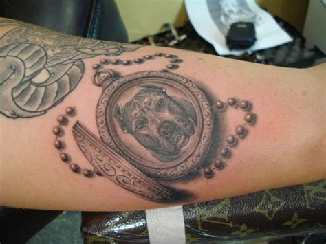 arm realistic dog medallion 3d tattoo by power tattoo company