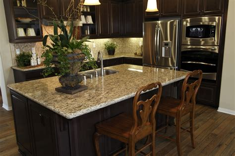 small shaped kitchen with granite island the slate blue walls gives refreshing vibe space without
