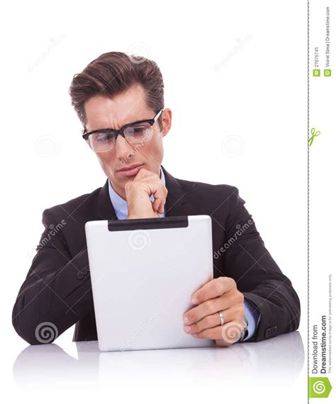 reading on tablet serious business reading on his tablet pad stock image
