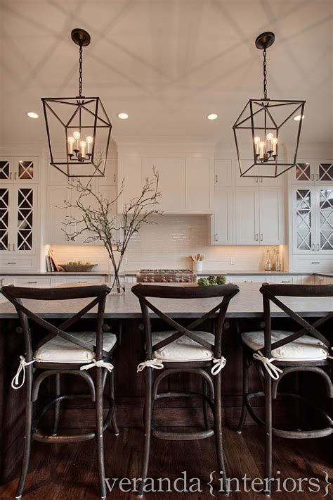 lighting over island white kitchen cross mullions on glass windows dark