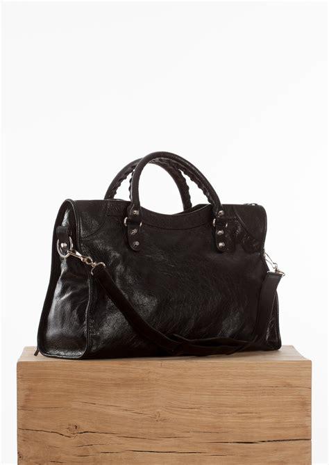 Guess Who The Balenciaga City Bag by Balenciaga Black Classic City Bag With Silver Hardware In