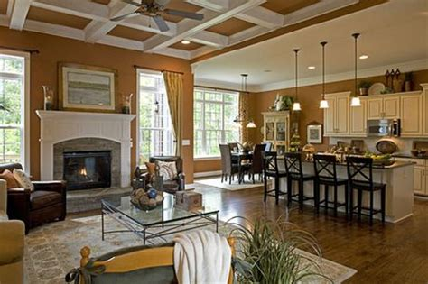 a white coffered ceiling with the warm tone found on the