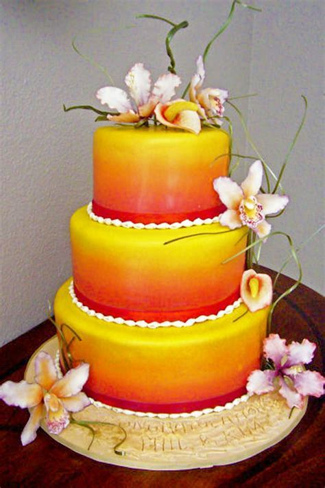 3 tier fondant tropical wedding cake with red, orange and